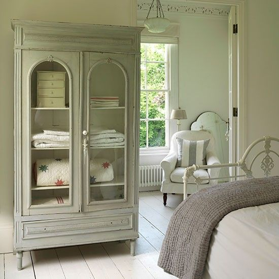 pale vintage shabby chic bedroom with painted armoire