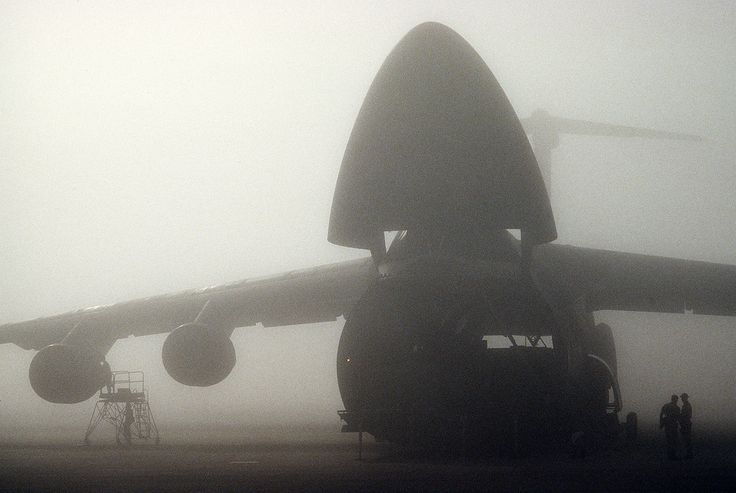A C-5 Galaxy, assigned to the 709th Military Airlift Squadron at Dover Air Force Base, Del., sits in dense fog as maintenance crews make repairs and systems checks during Operation Desert Shield in Southwest Asia. (U.S. Air Force photo/Staff Sgt. Corkran Lee)