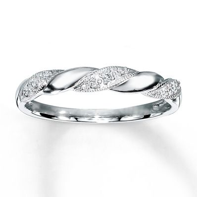 Twists lined with sparkling diamonds spiral around this lovely anniversary ring for her. Crafted of 10K white gold, the ring has a total diamond weight of 1/20 carat. Diamond Total Carat Weight may range from .04 - .06 carats.