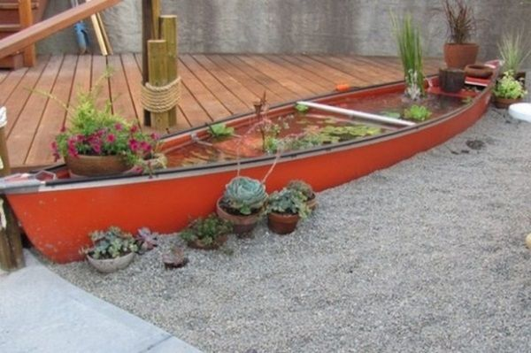 DIY Containers Garden Pond. This is spectacular!!!! I'd love to have this in my backyard. And I love how they put it next to their deck and in between the gravel. It has an abstract feel of being in the water next to a dock. :)