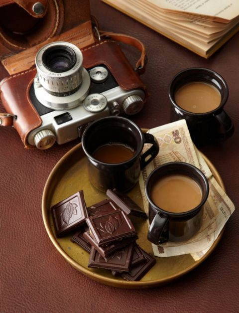 Camera - check (though mine would be digital!). Coffee - check (though I usually prefer tea). Cash - well, duh - check. Dark chocolate - check (as long as it's vegan and fair trade!)
