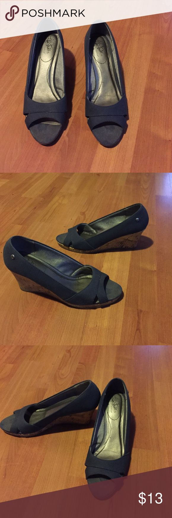 Cute navy blue wedges Only worn twice (once for an outdoor event). Like new condition, except for the toe area with some wear from outdoor use. This is not noticeable when you're wearing them. No other issues. They are cute and comfortable! The shoe material is fabric. Great for many outfits!! Life Stride Shoes Wedges