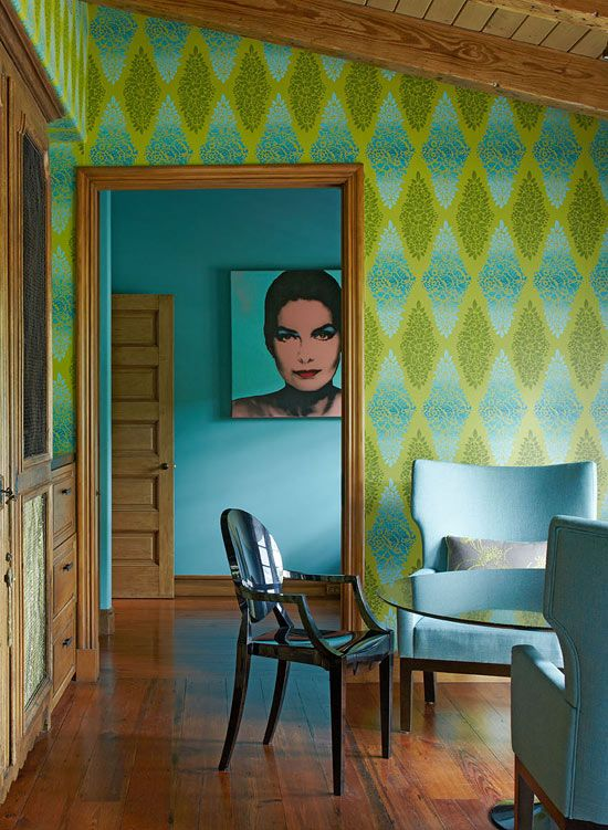 Electric turquoise and lime green star in the sitting room. The cool colors pop against the rich wood surrounding.