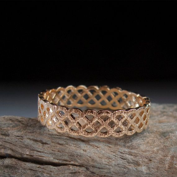 Celtic gold ring A Somewhat rugged textured gold ring featuring a single and repeating Celtic art pattern in a Eternity band 360 style. Rich in delicate textures and scratches giving it a slightly antique and rugged look Very comfortable and easy to wear for days. With Each Ring made by hand this Celtic gold ring every ring is a perfect fit Made to last from Solid Gold or Sterling Silver. Free Shipping worldwide!