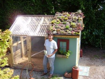 Awesome! Chicken coop with a green roof!
