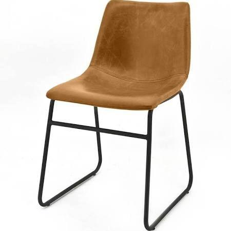 By-Boo Stoel Logan Lichtbruin  Description: De Stoel Logan lichtbruin heeft een stoere en industriële uitstraling. De zitting is gemaakt van lichtbruin leer en de stoel heeft een onderstel van zwart metaal.Door zijn eenvoudige uitstraling en neutrale kleur past de stoel in veel verschillende interieurstijlen. De Logan is zeer geschikt als eetkamerstoel maar kan ook uiteraard een plekje krijgen in de woonkamer.De afmetingen van de stoel zijn 81x46x44 cm. De Stoel Logan is ook verkrijgbaar in…
