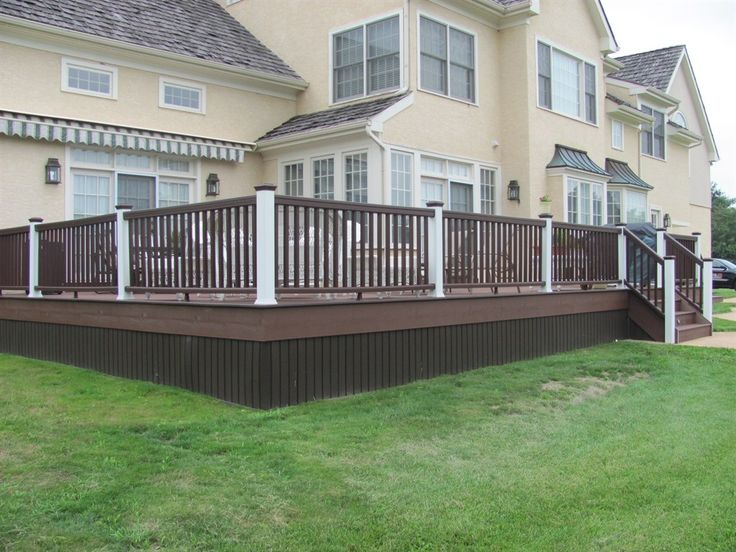 Brown Deck Yellow House Deck Railing Including Light
