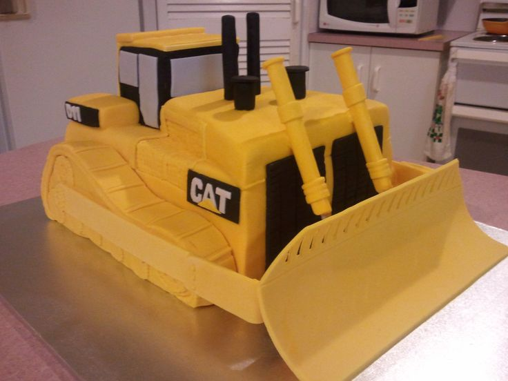 cat dozer - this was my first time making a 3D type cake, i had to google what a d11 dozer actually looked like before I started. i had no idea. Chocolate cake with fondant and gumpaste parts. I'm really happy with how it turned out