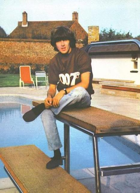 """George Harrison wearing 007 tee (interesting that the house isn't """"painted"""" yet!)"""