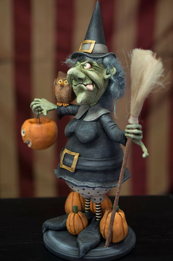Esmeralda loves Halloween, but she cant understand why all the kids run away from her! Honestly, all she wants to do is give them some treats. Hand-sculpted from papier-mache, painted in acrylic washes, stained and sealed. Esmeralda is a big piece of art, standing at approx. 17 tall on a wood base. Lots of detail including a straw broom and wool hair. She comes to you signed, dated and with a Certificate of Authenticity.