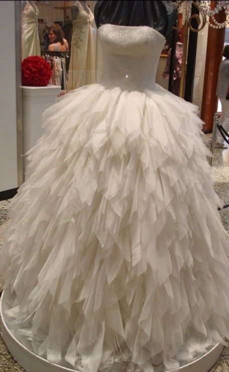 Darb Bridal Couture. The delicate beading on the bodice can be seen in this photo. Statement wedding dress.