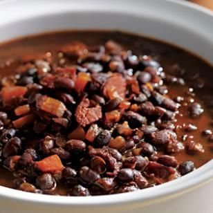 Bobby Flay's Honey-Rum Baked Black Beans Recipe - Chef Bobby Flay cooked these baked black beans, spiked with chorizo and rum, on one of his TV shows. This recipe sounds delicious....