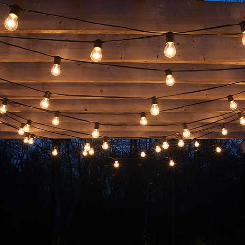 Outdoor Can Light: Drape patio lights from pergolas #Summer #DIY,Lighting