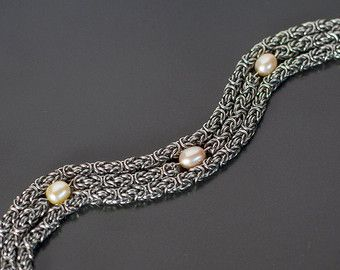 """Inspired by 1920's elegance - it's going to be tough to part with this beauty  Featuring approximately 576 individually woven rings, 3 freshwater pearls and a classy clasp.  All metal components are stainless steel and therefore will not rust and is extremely strong despite it's delicate appearance.  Length: 17cm/6.7"""""""