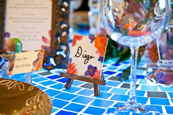 Mini canvas on mini easle place cards. Our Frida-inspired wedding feature on The Frosted Petticoat Photo by: PhatDogVisuals.com Wedding Planner: The Wedding Planners.ca Decor: DTFloralandDesign.com