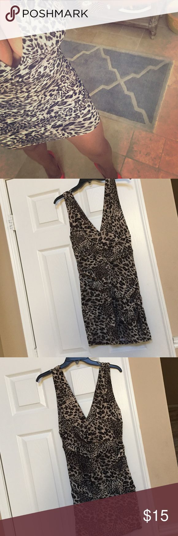 Pleated bodycon animal print mini dress Sexy animal print bodycon mini! Pleating throughout for flattering fit, deep v.  Size M. Worn once. Dresses Mini