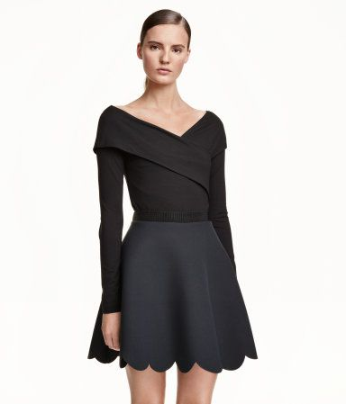 Long-sleeved, off-the-shoulder top in jersey with a slight sheen. Gently draped, wrapover neckline front and back.