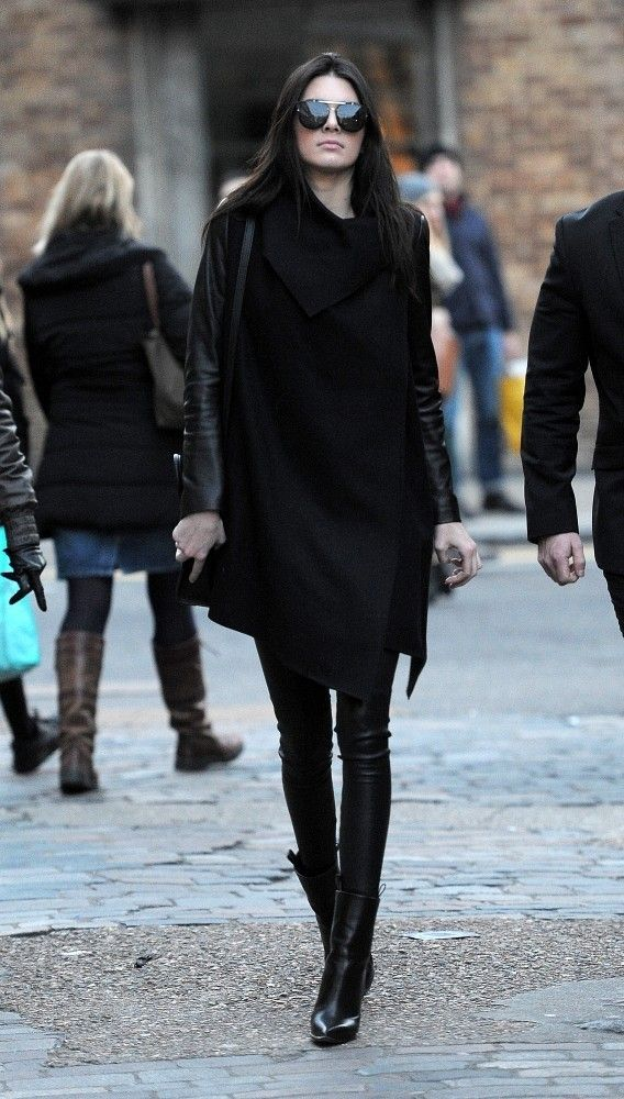 Kendall Jenner at Topshop • sexy • all in black • sunglasses • long black boots • big black long coat • winter style •