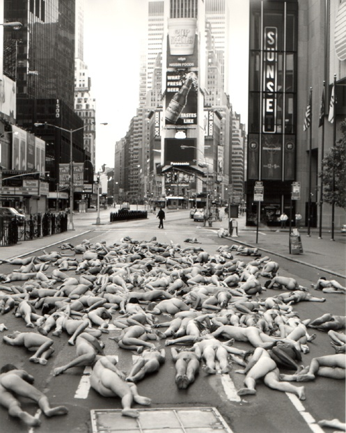 "NYC-Times Square,1997 by Spencer Tunick.  I'm honored to have participated as one of 150 nudes in this picture.  It was six AM on a cold April morning, took 30 seconds to shoot & it was over.  Spencer was arrested on the spot by the NYPD for ""promoting exposure of a person."""