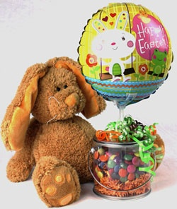 15 best easter gift baskets images on pinterest easter gift this ganz easter bunny is holding a clear plastic container of rainbow colored smartiess topped with a happy easter balloon and decorated with rainbow negle Images
