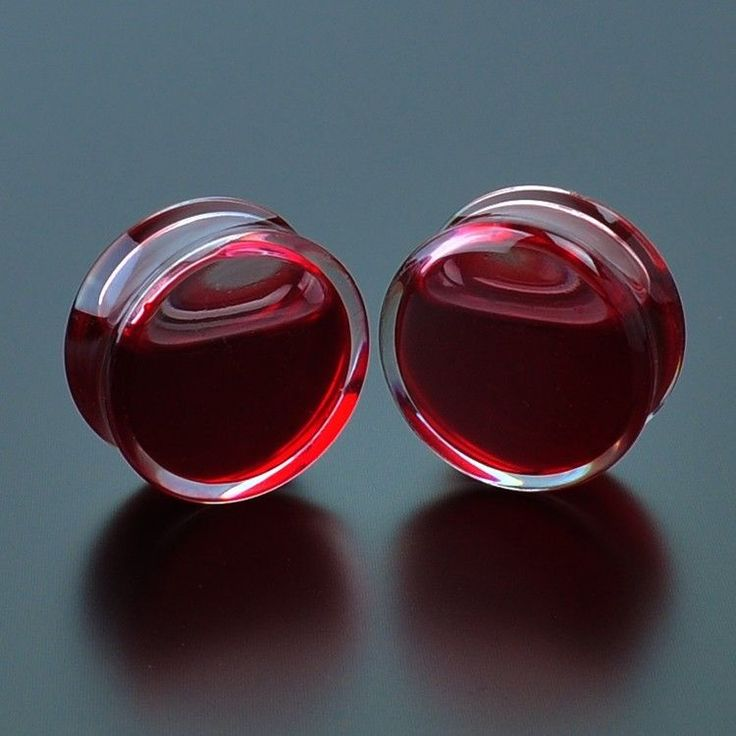 I really want one of these... Blood Red Liquid Filled Acrylic Globe Plugs Tunnel Ear Gauge Double Flare Saddle