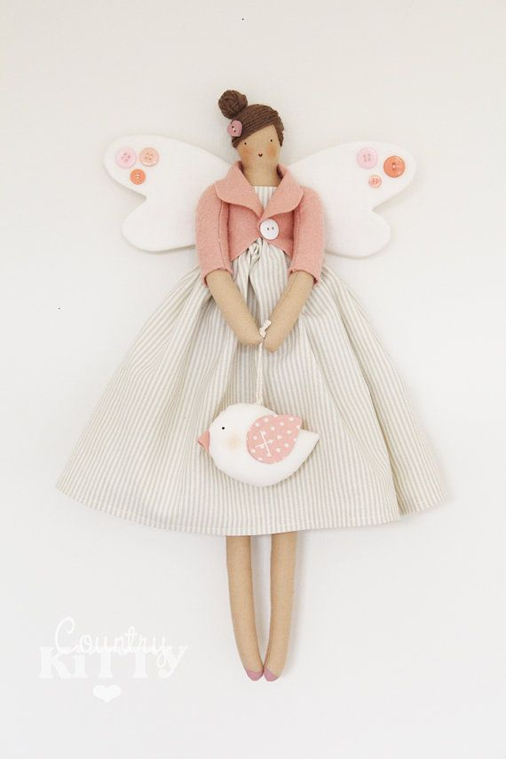 This is a pretty angel fairy handmade by me using cotton and felt fabrics, buttons and a lot of love.  She is approximately 40 cm tall.  You