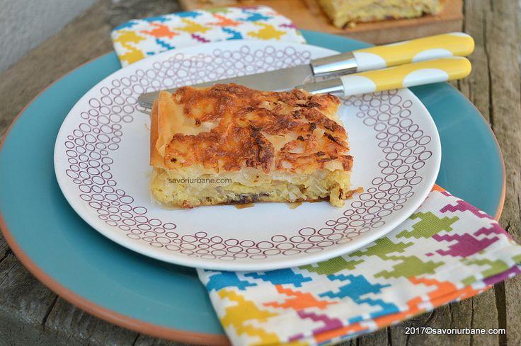 Placinta cu cartofi, ceapa si cascaval la cuptor. O placinta taraneasca simpla, rapida si ieftina, cu foi facute in casa sau din comert. Din compozitia ei