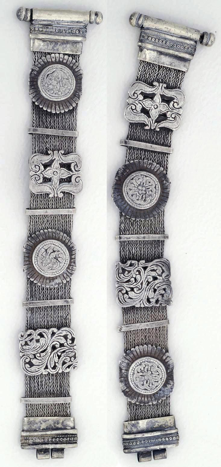 Central India | Pair of silver Bracelets made out of strands of braided silver wire with floral panels and silver bands. | ca. 1920
