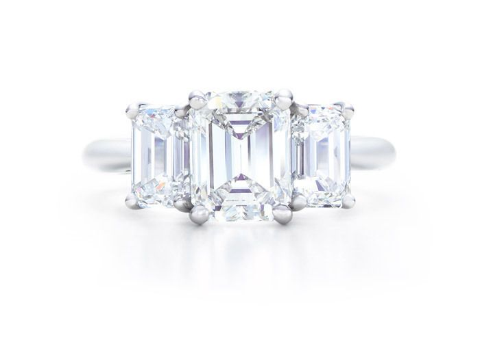 I just love this look. 3 stone, emerald cut, on a plain platinum band. Someday . . .