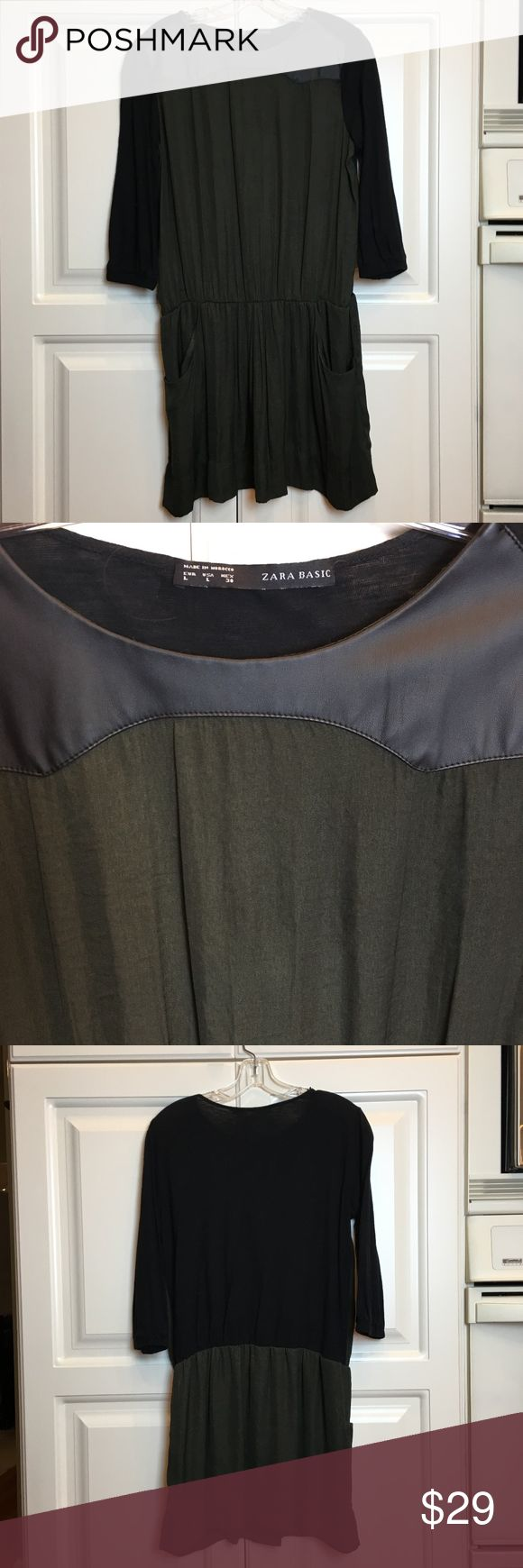 "*SALE* Zara Colorblock Dress Sz L Zara Basic Colorblock Dress  Olive Green & Black with Faux Leather Detail at Neckline Green Sections are silky, Black are Knit Skirt is Lined - Fabric Content tag was removed Elastic Waist, Front Pockets Measures 19"" Across Chest Laying Flat 36"" Shoulder to Hemline zara Dresses Mini"