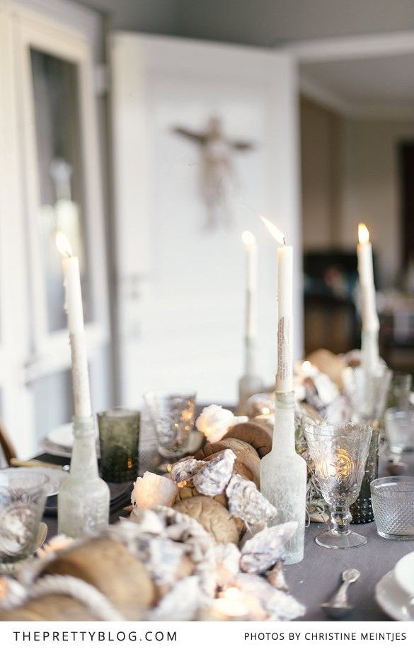 a great inspiration from a beach christmas table setting to use for your beach wedding. the use of shells and floats candles old bottles and plants is so chic. look around for yourself.  via:theprettyblog.com  Sunshine:-)