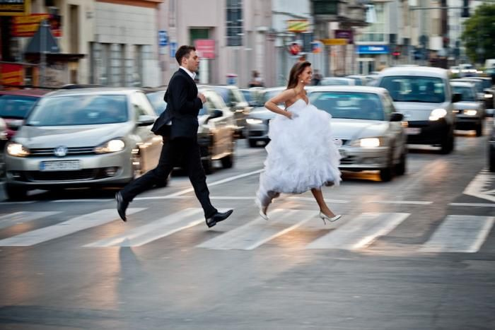 WPJA 2011 Q2 Contest - TRANSPORTATION - 7th Place - Photo By: Piotr Gajewski from Wielkopolskie, Poland  Judges Comments:  Yes, walking and running is a mode of transportation. I've seen this photo staged many times for portraits, but capturing the bride and groom in the same position, mid-stride, as they ran across a street made for a compelling photograph.  More photos/info at http://www.WPJA.com/
