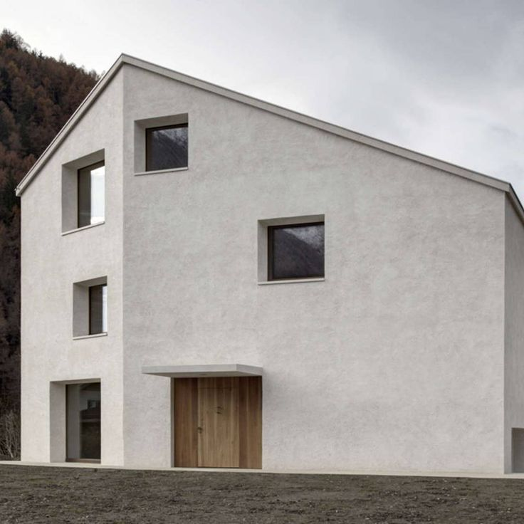 Part of today's #ArchitizerCollection, the House at Mill Creek is as interesting to look at as it is to look out of/ Coated in white plaster made from local materials, the house stands out starkly from its surroundings, while irregularly placed windows stare out like great eyes in every direction/ Discover the full project on Architizer.com . . . . . #architizer #architecture #PedevillaArchitects #Pedevilla #HouseAtMillCreek #Italy