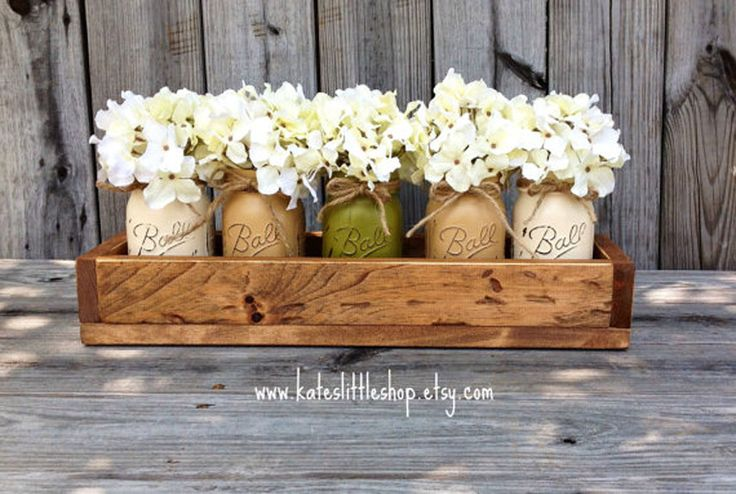 This cute display tray fits exactly five Mason jars full of flowers. You can mix and match color elements (both flower petals and painted glass) to create your perfect planter. ($64, kateslittleshop.etsy.com)  Get more Mason jar ideas at Country Living.  - GoodHousekeeping.com