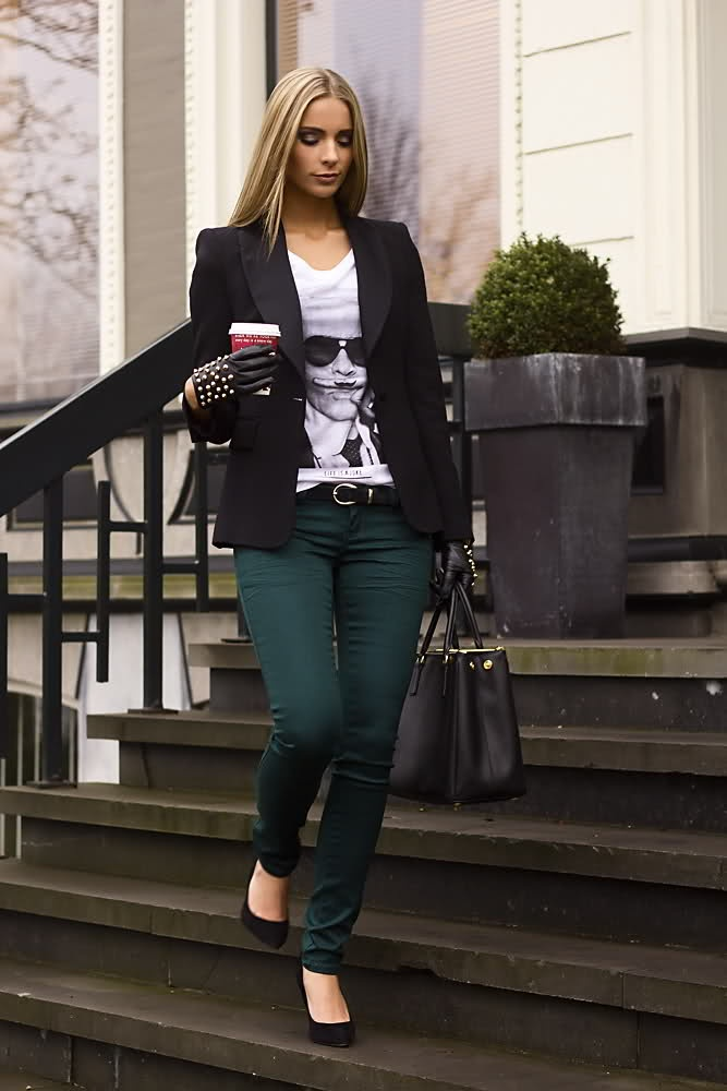 green pants, graphic tee, black blazer, leather accessories