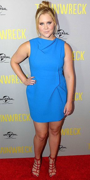 Last Night's Look: Love It or Leave It? Vote Now! | AMY SCHUMER  | in a blue pleated dress and red, strappy sandals at the premiere of Trainwreck in Melbourne, Australia.