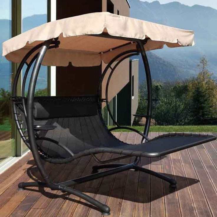 Furniture Marvellous Garden Swing Design Ideas With Cream Umbrella Black Metals Material Design
