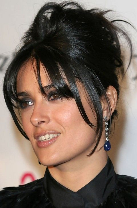 Salma Hayek Hairstyles: Fun French Twist This French twist is chic and fun, especially the layered fringes! Do you like it? Maybe you can sport it for some friends or family gatherings.