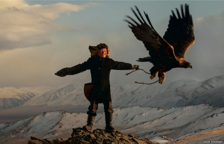Ashol-Pan training her eagle. A thirteen year old giirl hunting with a golden eagle in Mongolia