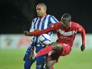 Noah Chivuta of Free State Stars battling Delron Buckley of Maritzburg United during the Absa Premiership, Maritzburg United v Free State Stars at the Harry Gwala Stadium in Pietermaritzburg.