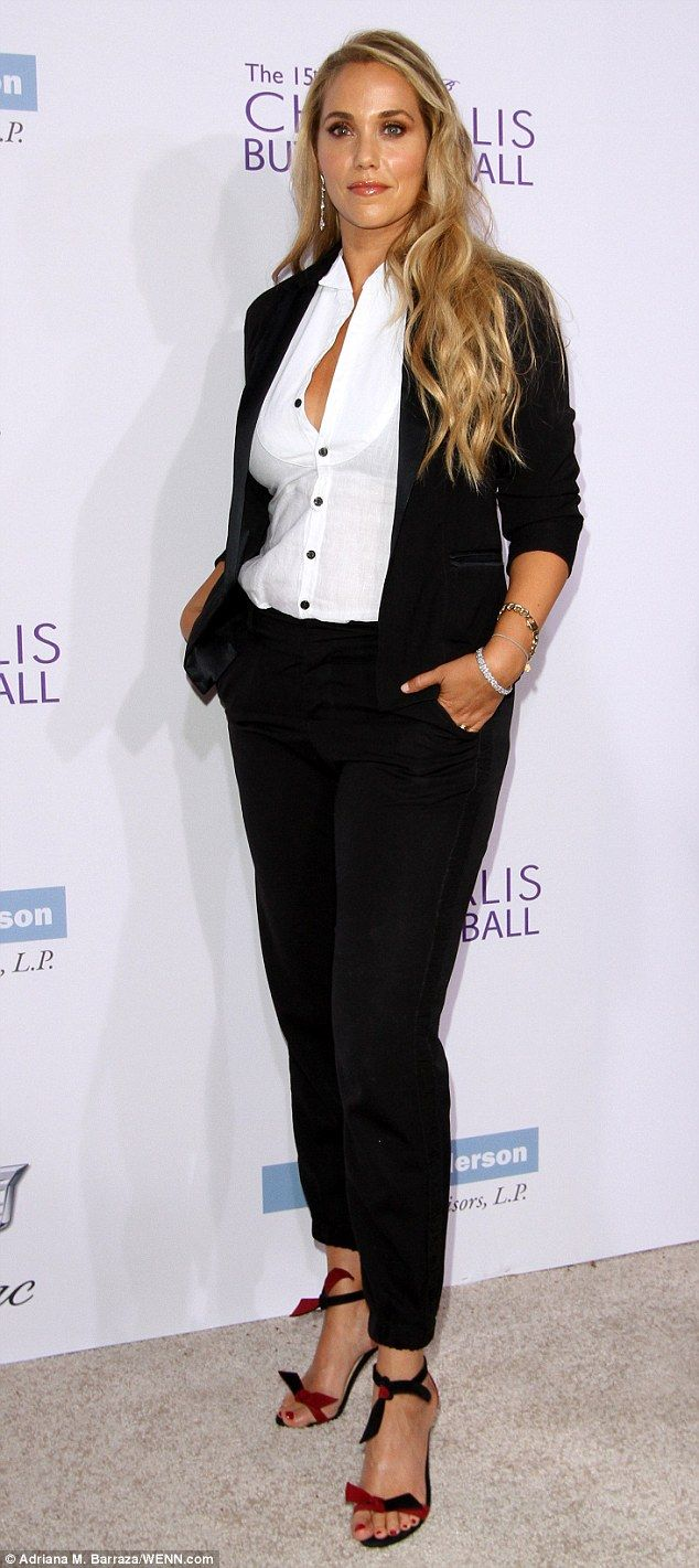 Subtly sexy: Elizabethg Berkley paired a black blazer and tailored pants with a white cotton shirt that she left slightly unbuttoned so as to reveal some cleavage at a charity event in LA on Saturday night