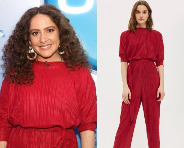 Maria Angelico wears this red jumpsuit in this episode of The Project on Wednesday November 8th, 2017. It is the Topshop Matte Plisse Batwing Jumpsuit.