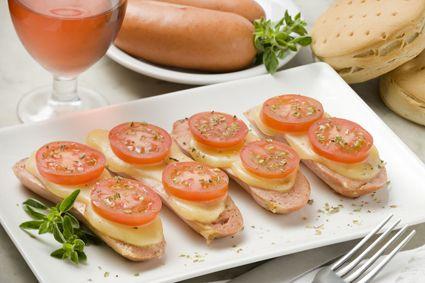 Gordas con tomate, queso y orégano