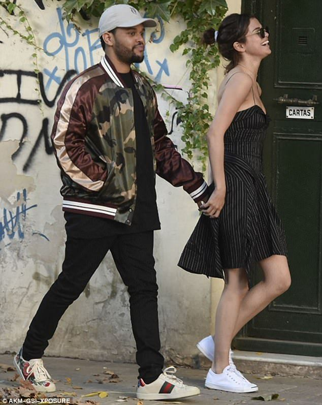 Plenty to smile about: Selena Gomez looked happier than ever with The Weeknd as they enjoyed a romantic stroll around the sights of Buenos Aires, Argentina, on Tuesday afternoon
