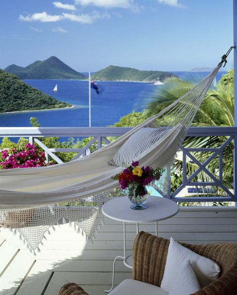 It's All About the View - A hammock on a veranda overlooking a tropical island.