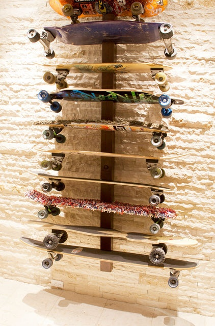 Pretty awesome house.  Great idea for storing skateboards.