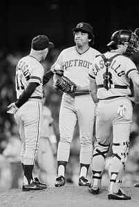 . Detroit Tigers\' relief pitcher Aurelio Lopez, right, listens as he gets instructions from manager Sparky Anderson as Lopez replaces starter Juan Berenguer against the New York Yankees in the fourth inning, June 26, 1984, in New York. (AP Photo/Richard Drew)