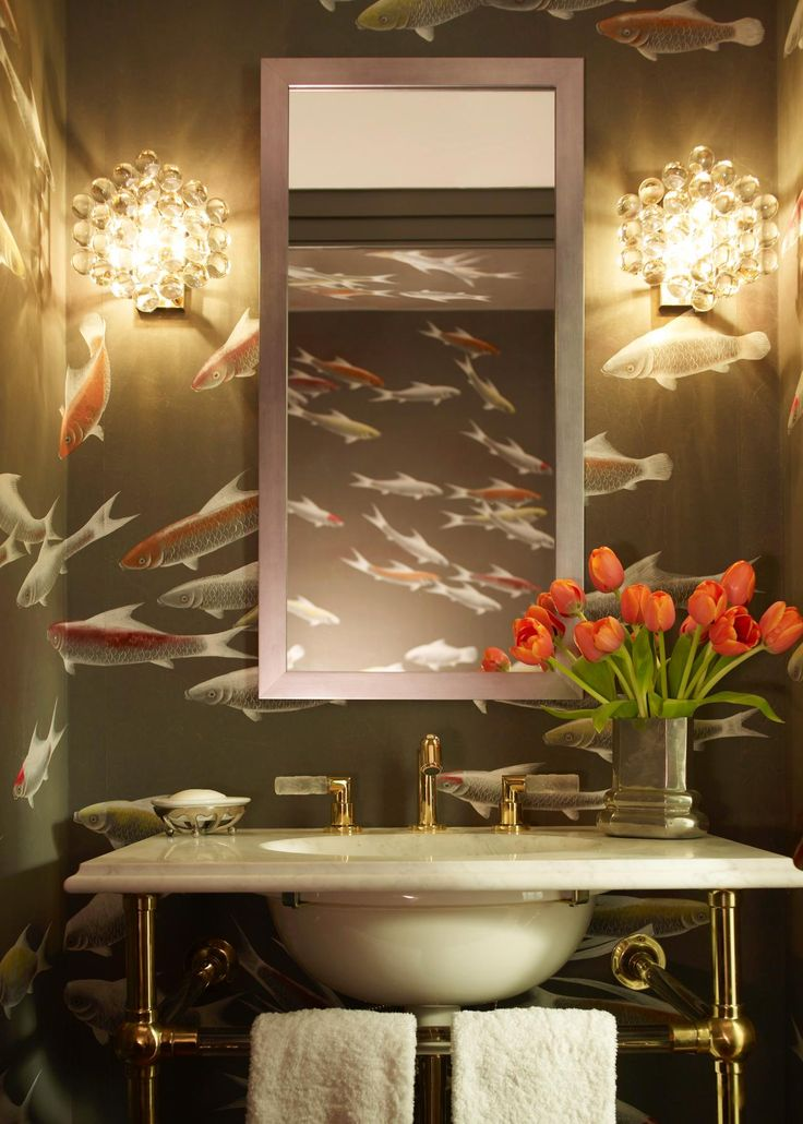 the walls of this california powder room are covered with handpainted de gournay wallpaper