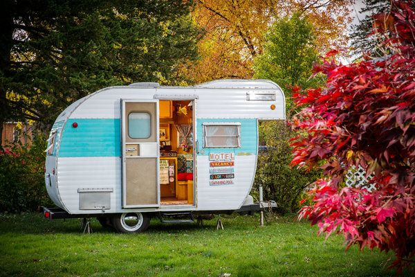 """Cuddle Up in This - NYTimes.com   """"Sleeping in one of these is just great,"""" she said, nestled into the trailer's dinette, which has booth seats and a foldable table that convert into a bed. """"Especially at night, if it starts raining. It's a great sound, the rain on the roof."""""""