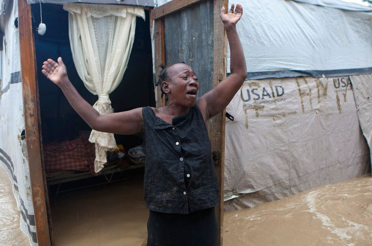 A woman cries out in front of her flooded house caused by heavy rains from Hurricane Sandy in Port-au-Prince, Haiti, on Oct. 25. Hurricane Sandy rumbled across mountainous eastern Cuba and headed toward the Bahamas on Thursday as a Category 2 storm, bringing heavy rains and blistering winds. (Dieu Nalio Chery/Associated Press)